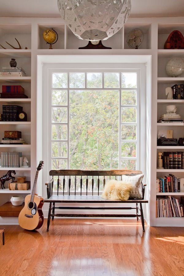 Built Ins Around An Incredible Window With A Comfy Bench