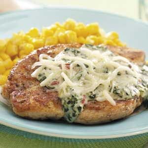"""Chicken with Florentine Sauce Recipe -""""Here is my very favorite chicken-and-spinach recipe,"""" writes Julie Fitzgerald from St. Louis, Missouri. A creamy topping and pretty presentation make it elegant enough for company but it's also fast to fix on busy weeknights!"""