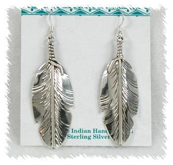 Handmade sterling,silver  turquoise Feather wire earrings.