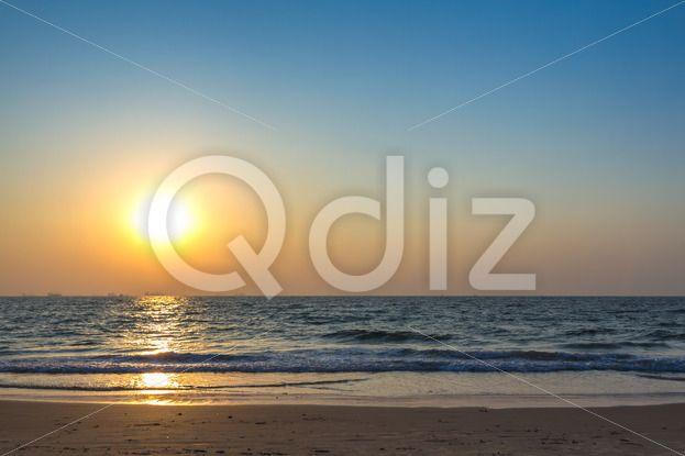 Qdiz Stock Photos | Sunset at sea beach,  #afterglow #arabian #beach #calm #coast #coastline #decline #dream #dusk #evening #fall #goa #horizon #india #mood #nature #ocean #reflection #sand #sea #seascape #set #shore #sky #summer #Sun #sundown #Sunset #tranquility #twilight #water #wave #wet #wildlife
