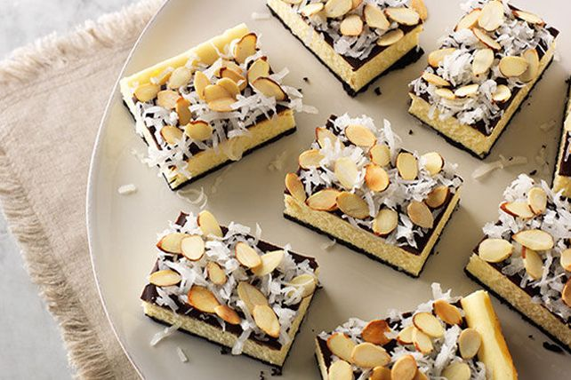 What's a Coconut Joy Cheesecake Bar?  Think coconut, chocolate and cheesecake deliciousness in a scrumptious chocolate cookie crust.