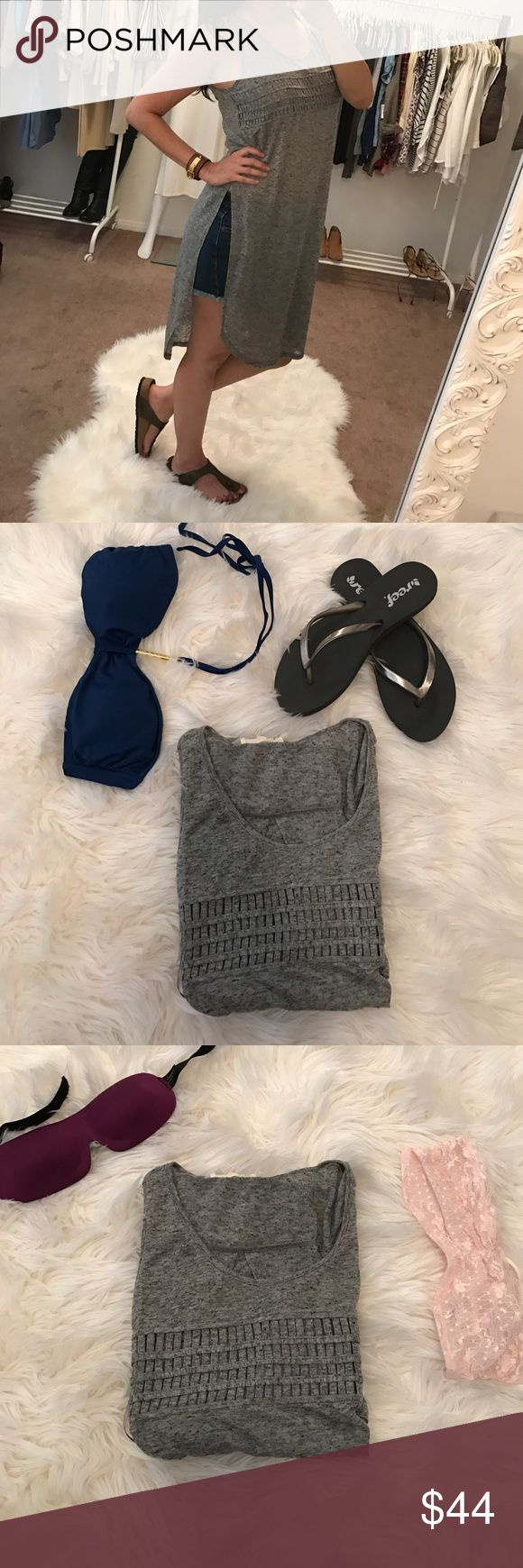 Versatile Grey Cut Out Tunic Versatile Cut Out Tunic.  Love the versatility of this tunic.  Wear it over shorts, as a sexy nighty or even as a swimsuit cover-up.  Very lightweight, Heather grey gorgeous cutout/braided detail on front. Tops Tunics