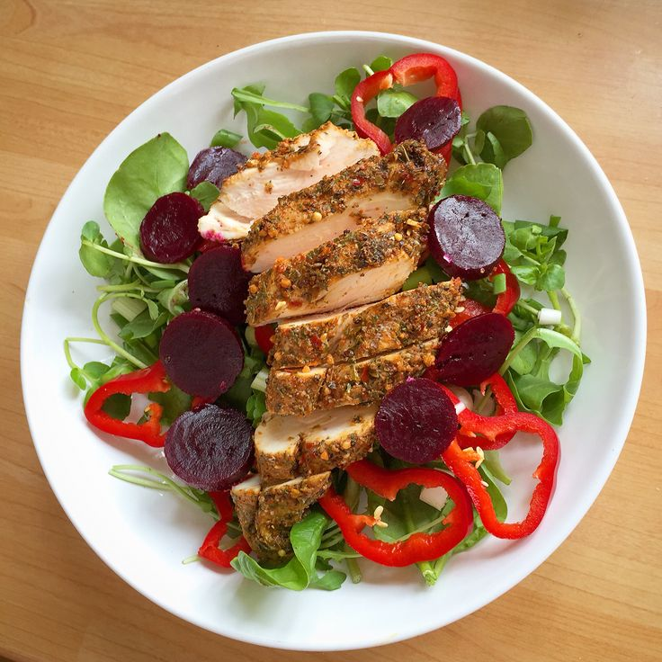 Left over Moroccan Chicken breast on a bed of mixed salad leaves, red pepper rings, spicy beetroot and spring onion dressed with balsamic vinegar.
