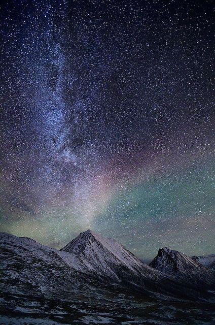 The Milkyway and a faint aurora over Sørtinden in Tromvik