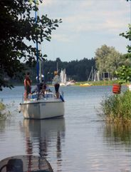 Mazury Lakes in Poland...I have been there, it is so peaceful and beautiful! And inexpensive to rent a sailboat. We went fishing, swimming in the lake and just sailing!...