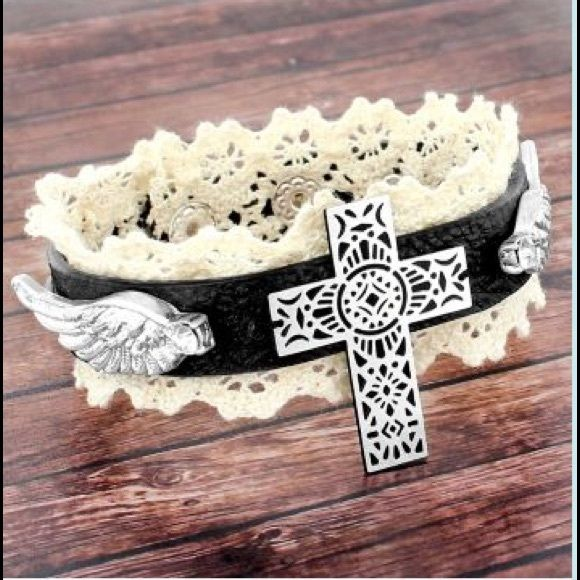 "BLACK WINGED CROSS FAUX LEATHER & LACE BRACELET Worn silvertone. Faux black leather. Crystal accents. 8.5"" long and 1.25"" wide. 2 adjustable snap closure. Lead compliant. NO TRADES! Reasonable offers using the ""offer"" feature are welcomed and considered. Jewelry Bracelets"