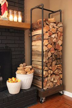 Indoor Firewood Storage - DIY Instructions for painted black plumbing pipe holder with wooden base and casters.