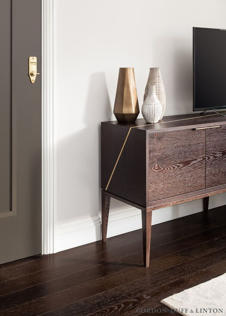 Detail of our bespoke media unit with brass inlay running up the side and along the top.   #GD&LBespokeFurniture