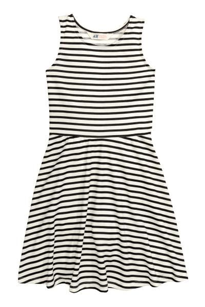 H&M girls- Sleeveless jersey dress: Knee-length, sleeveless dress in patterned jersey with a seam at the waist and a circular skirt.