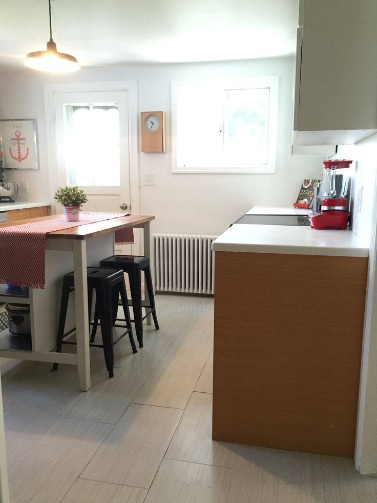 White and wood modern nautical kitchen with doug fir cabinets from Ikea and Semihandmade