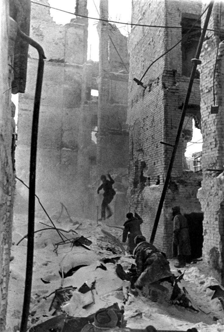 Soviet soldiers advance through the snow-covered ruins during the Battle of Stalingrad. The Axis offensive to capture Stalingrad began on 23 August 1942 and would culminate in one of the bloodiest and most destructive battles in military history. The Axis suffered 850,000 total casualties (wounded, killed, captured) 400,000 Germans, 200,000 Romanians, 130,000 Italians, and 120,000 Hungarians,Volgograd Oblast, Russia, Soviet Union. January 1943.
