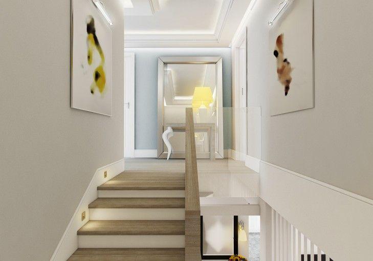 Projekt korytarza w rezydencji w Łomiankach. Schody z dębu bielonego i pastelowe ściany odbijaja się w dekoracyjnym lustrze Philippe'a Starck'a na wieńczącej osi wejścia.