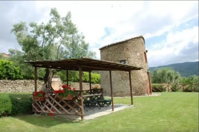 This beautiful tiny house, located in Tuoro sul Trasimeno, Umbria, Italy, used to be an abandoned stable. It was remodeled and now it's known as The Tower.