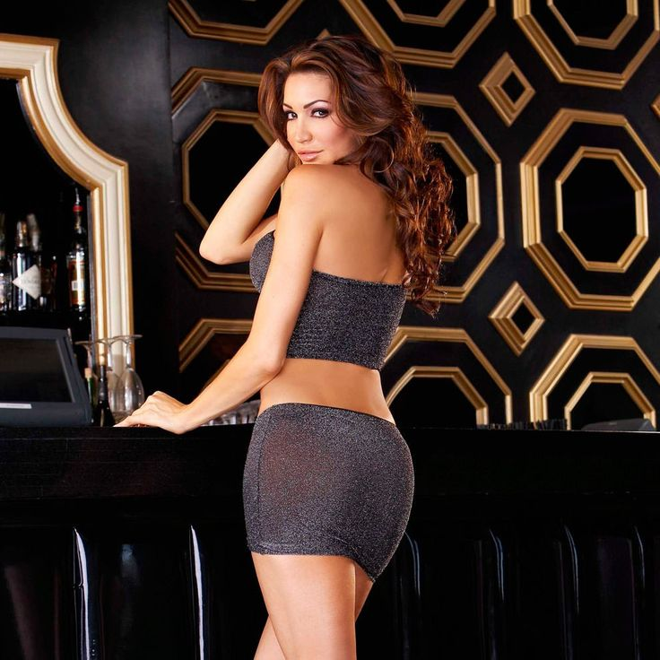 Every girl loves sparkles! Shine all night long in this slinky, shimmering tube top and miniskirt set. Optional neck strap can be tucked away for full tube effect. £33.00 free Postage & Packing.