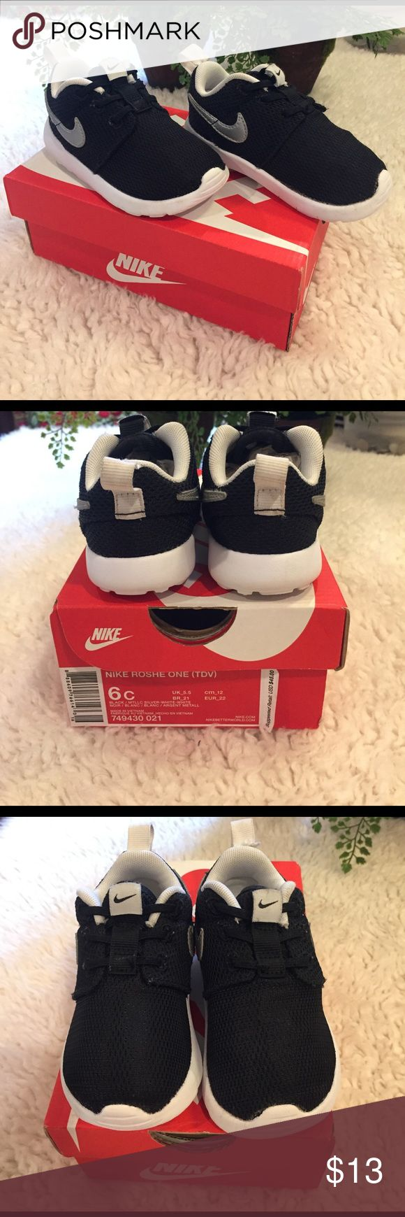 Black Toddler Nike roshe one 6C Black toddler Nike roshe's in size 6C. Worn a few times and back flap on left shoe has a rip. Still in pretty great condition. Nike Shoes Sneakers