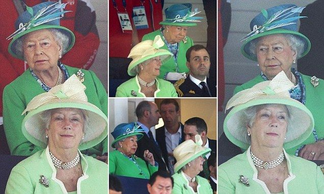 You're spoiling one's view! The Queen struggles to watch the Commonwealth Games from behind lady-in-waiting's huge hat... which is a clashing shade of green