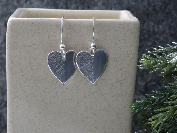 Beautiful handmade silver drop minimalist heart earrings.   The delicate leaf texture on one half of these heart drop shaped silver heart is a lovely feature. The earrings ... #trending #etsy #hmuk #styl