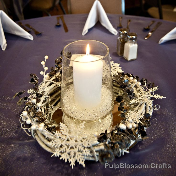 Make greenery wreaths, add pink roses, glittered pinecones. Set on mirrors, candle in centerpiece.