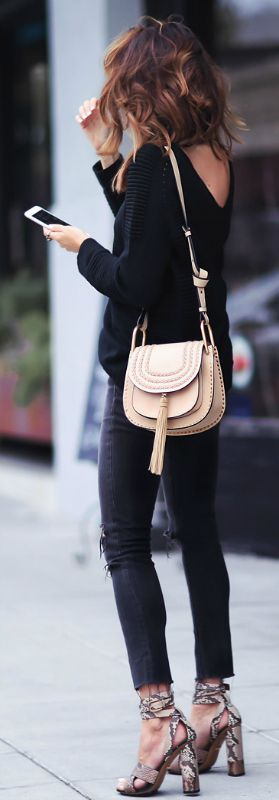 all black outfit + pair of statement print platforms + gorgeous faux snakeskin pair + Gucci + Erica Hoida + ultra chic + distressed jeans + knit sweater + cute beige mini bag + great contrast + darker tones.   Sweater: Belstaff, Jeans: Rag & Bone,Shoes: Gucci, Bag: Chloe.