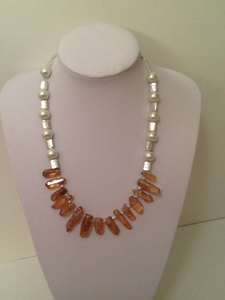 Amber Luster Stones and Glass Pearls with silver plated accents.  #handmadenecklace #amber #statement #necklace #handcrafted #beinspired