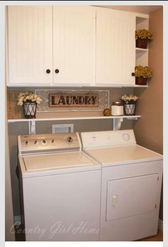 Small laundry room idea in taupe and white with a shelf over the washer and dryer.