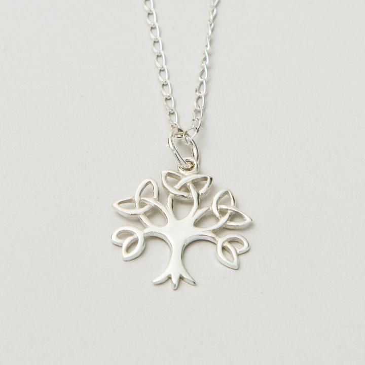 In Ireland, the Tree of Life symbol dates back to Druid times. It signifies regrowth, protection, and wisdom. Here it is beautifully recreated using the ancient Celtic symbol of eternity, the Trinity Knot. An Irish gift to be treasured. Handcrafted in county Kilkenny.