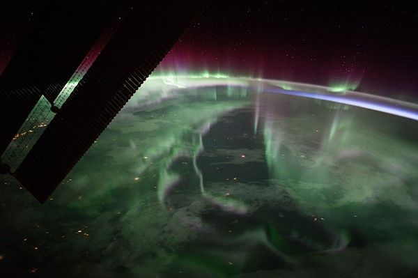"(Sept. 15, 2017) – The spectacular aurora borealis, or the ""northern lights,"" over Canada is sighted from the space station near the highest point of its orbital path. The station's main solar arrays are seen in the left foreground."