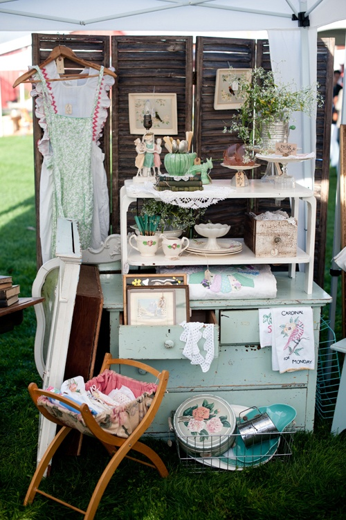 great wooden room divider as a neutral backdrop for the vintage vignette