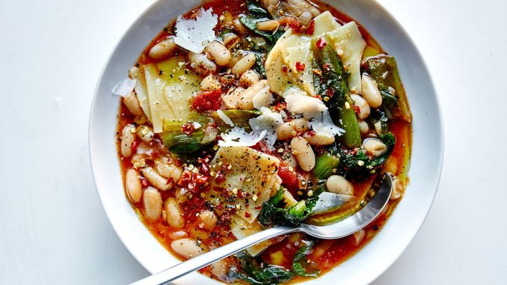 Parmesan rind and a kitchen sink's worth of aromatics give heady flavor to this classic pasta fagioli recipe with beans and pasta.