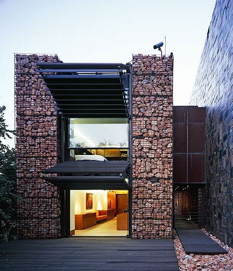 Credited with making a significant contribution to the evolution of the modernist house, this building never loses contact with the expansive views of the man-made landscape of Johannesburg and the Magaliesburg beyond