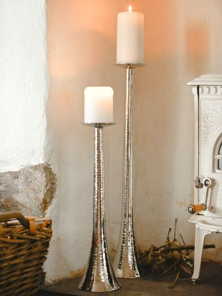 floor standing candle stands but with turquoise pillers on them.