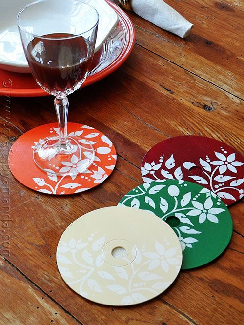These are really cute! I'm guessing there is felt or cork on the bottom?-- Stenciled CD/DVD Coasters - Crafts by Amanda