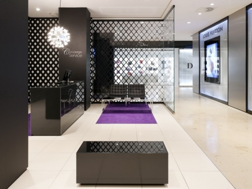 Munich. This display uses line to its favor with very sharp, bold lines and shapes. The checked pattern is very think and creates a visual while still making the space feel sophisticated. Other than the light fixture, there are all rectangular shaped items and visuals to give the space a rigid, sleek feel.