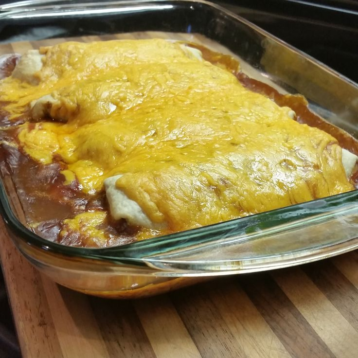 Wet Burritos - restaurant quality! Filling; 1# of ground beef, 1 can refried beans, 1 pkg of taco seasoning, stir in 1 box of prepared mexican rice (only cook 1/2 of time stated on box), place on tortilla, add veggies you want & roll up. Sauce; Blend together & warm up ,1 can enchilada sauce & 1 can of beef gravy, pour over burritos, top with cheese, bake till cheese melts at 350. Makes 8, I freeze 4 for later! I just make a new batch of sauce. So good, got the recipe from a good friend!