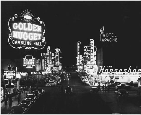 """Las Vegas. Casinos and hotels light up the night for gamblers and tourists in 1950s Las Vegas. The birth of """"the Strip"""" in Las Vegas forever changed the face of legalized gambling in America and established a gambling Mecca that people from all walks of life could visit and enjoy.    © Corbis  Full Text: COPYRIGHT 2004 Gale, Cengage Learning."""