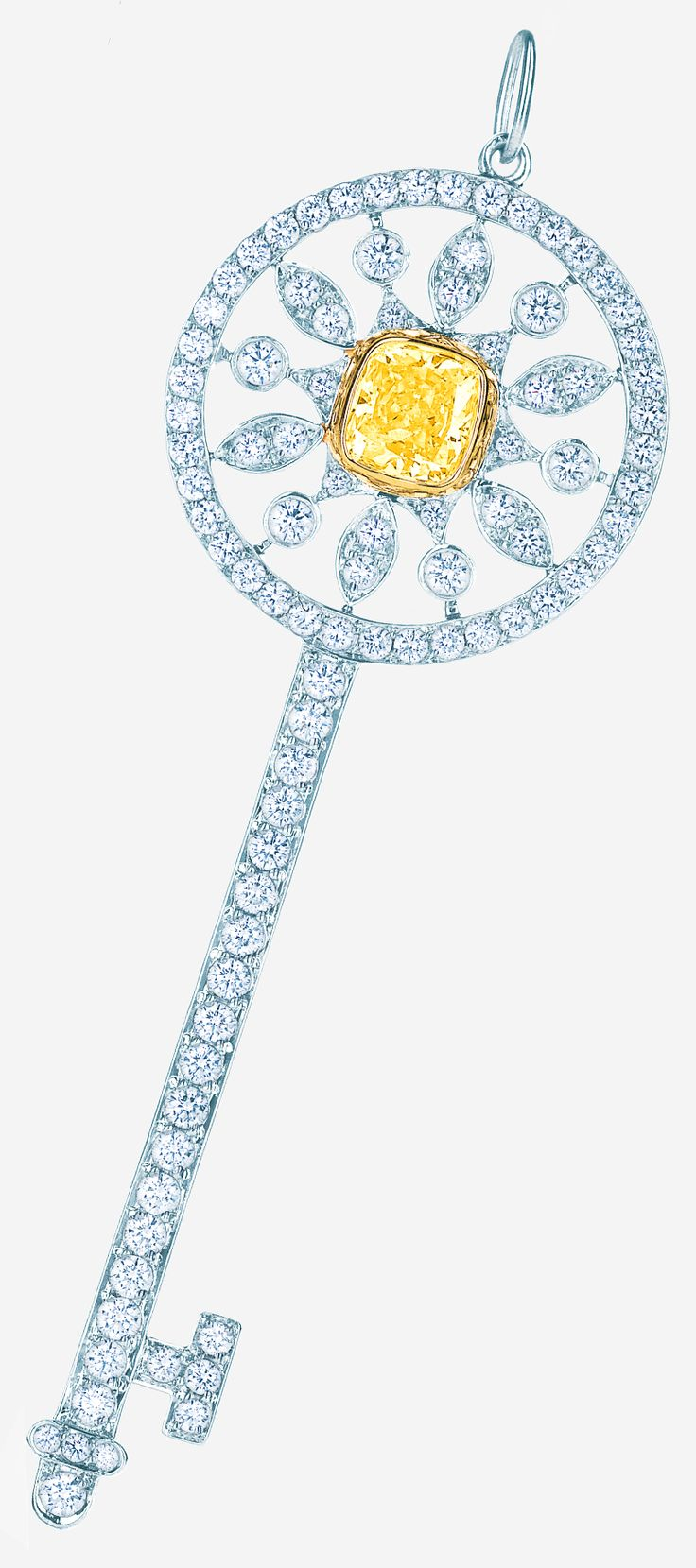 The key to her heart. Tiffany Keys star key pendant in platinum and 18k gold with a yellow diamond and round brilliant white diamonds.