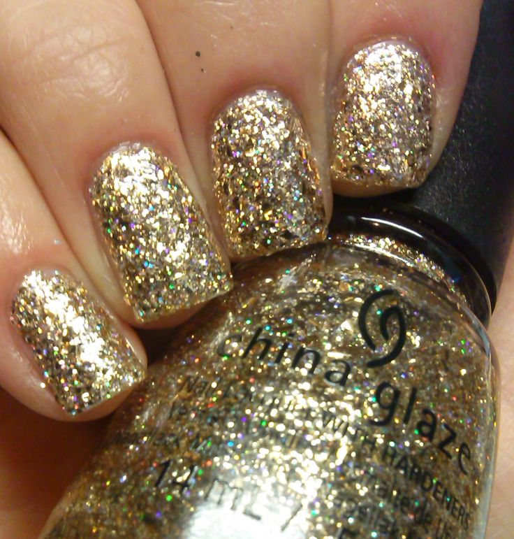 China Glaze - Counting Carats. Clear base polish with small gold glitters and medium sized gold hex glitters. It also has a holographic gold glitter running through it too.