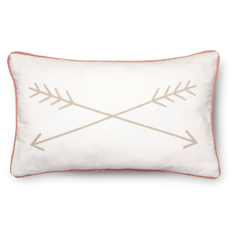 "The Archery Throw Pillow - 20""x12"" in Tan from the Pillowfort Explorer's Escape collection will look just right in a boy's or girl's room. The kids' throw pillow has a pair of arrows crossed on the front of it and a striped piping all around its narrow rectangular shape. Your child can rest their head on this throw pillow and dream of exploring forests as a frontiersman or in a world remade."