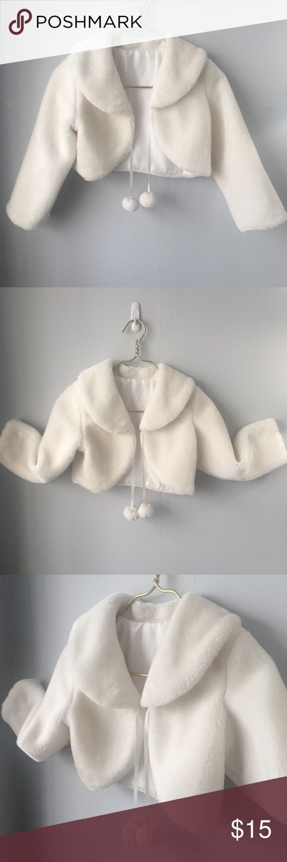 """Girl's Faux Fur White Cropped Pom Pom Jacket  Kids Adorable Faux Fur Cropped Jacket for a young girl Size L. The exterior is in Excellent condition, the lining has some discoloration and is torn at the arm pits. This is perfect for the holidays!  Size: Girl's L Color: Winter White Material: Faux Fur  Measurements: Pit to Pit 16"""" Shoulder to Shoulder 15"""" Sleeve Inseam 13"""" Length 12"""" Jackets & Coats"""