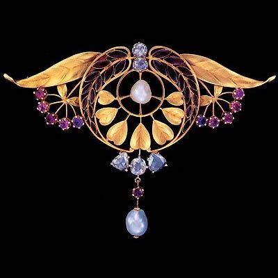 HENRI DUBRET 1872-1947 Art Nouveau Brooch  Gold Plique-à-jour enamel Almandine Garnet Diamond Pearl H: 5.5 cm (2.17 in)  W: 7.8 cm (3.07 in)  Marks: Signed: 'H. Dubret' Numbered: 472614. French, c.1903                                                                                                                                                                                 More