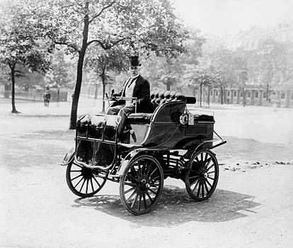 Electric CarRoger Wallace in his electric car, 1899. A Victorian man in formal dress driving an early electric car.    Roger Wallace in his electric car, 1899.   Credit: National Motor Museum / HIP / TopFoto