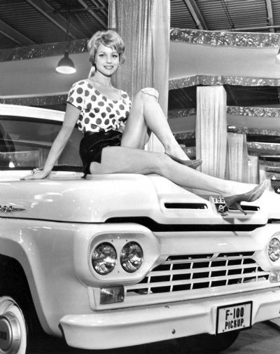 A Model Poses Atop A Ford F 100 Truck During The 1960