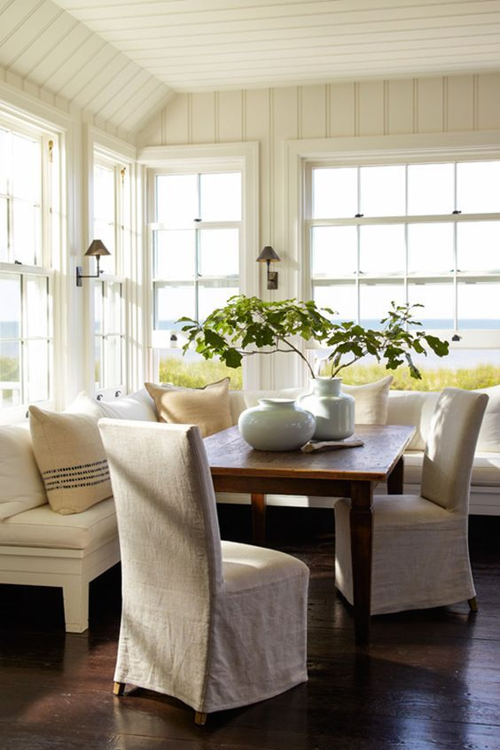 Banquette Dining -Tabletop vases and Linen Slipcovered Parsons Chairs