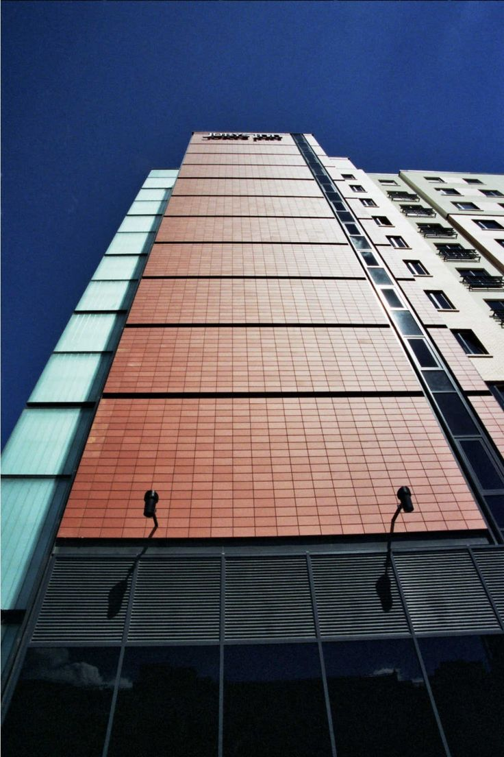 Ceramic ventilated facade solutions for building offices exterior cladding delivered by ermetik.ro