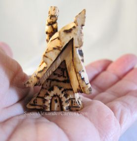 http://www.etsy.com/shop/SusanAlexanderCarves Fairy House carved from Basswood, then used Pyrography to detail.