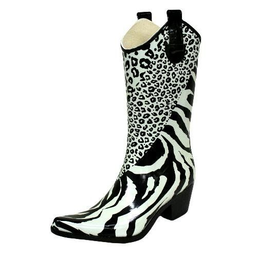 Black & White Animal Cowboy Rain Boots Size 6 Nature. $39.99. Imported. Boots are made of Rubber. Lined with a thin fabric to absorb moisture.. Shaft height measures approximately 11.5 inches.. Factory boxed and well packaged. Product measurements were taken using ladies size 7. Please note that measurements may vary by size accordingly.. rubber. Tip: Rain boots typically run a half to a full size bigger than you would usually wear.. Save 25% Off!