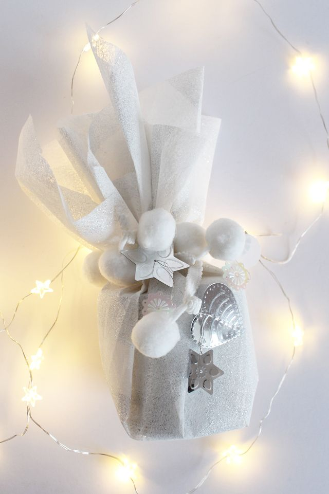 white and metallic gift wrapping