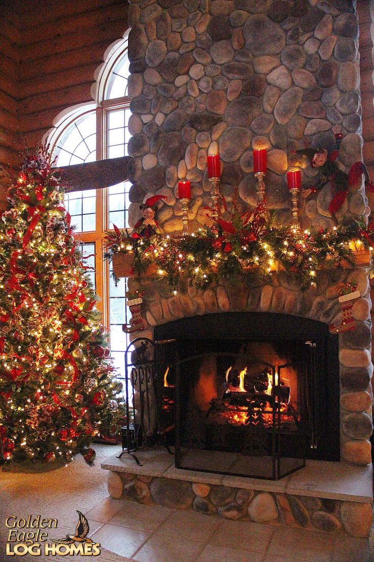 Cabin bedroom fireplace - Stunning Log Cabin Christmas Round The Fire