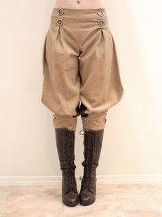 """Beautifully-tailored, hand-made women's traditional jodhpurs in beige thick rib corduroy with faux brass buttons and faux leather inner knee panels.  Will fit up to the following measurements:  Low waist: 31""""  Hip: Free size  Below knee: 14""""  Inseam: 16"""""""