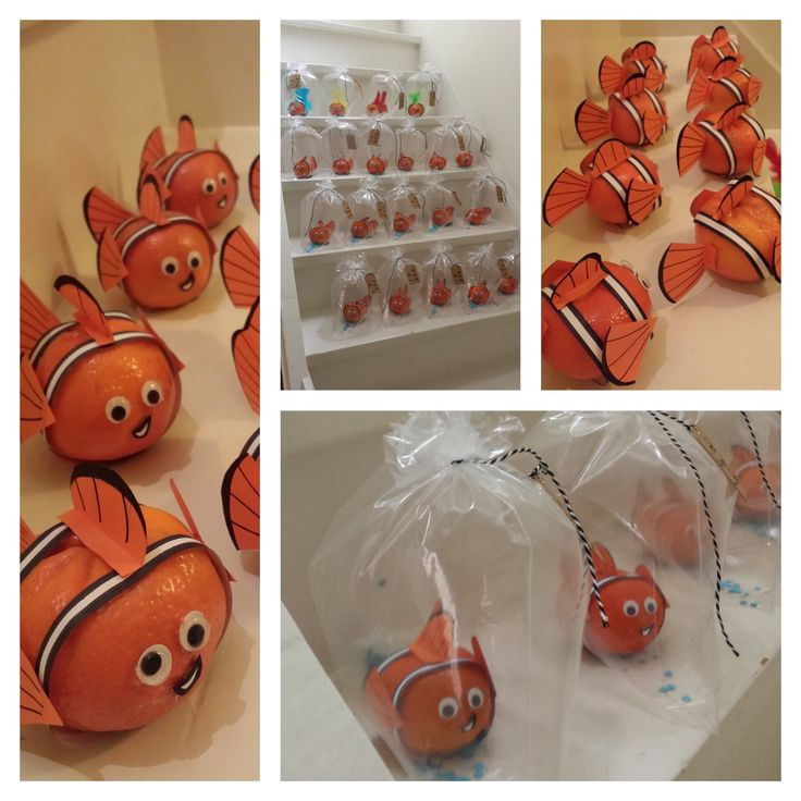 Nemo van mandarijn, Nemo of a tangerine. An easy healthy treat.  Using white and orange paper, black marker, little eyes (wiebeloogjes) and duplex tape (dubbelzijdig tape) (No scotch tape /plakband, no glue. That won't work) . A freezer bag (diepvries Zipp zakje) filled with air and some blue confetti, a string and a name label completes it.